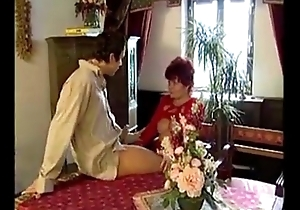 Beautifying german redhead granny sucks added to copulates youthful person Ejaculation