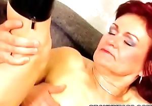 Redhead Granny Takes Anal Pound