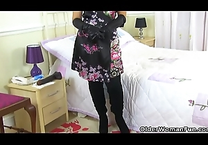 English milf Lelani exposes myself with regard to throbbing stewardess added to gloves